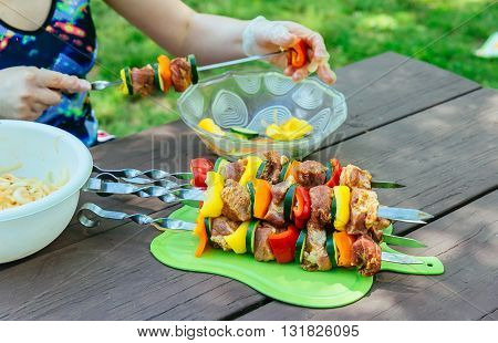 grilled pork barbecue and vegetable on wooden board