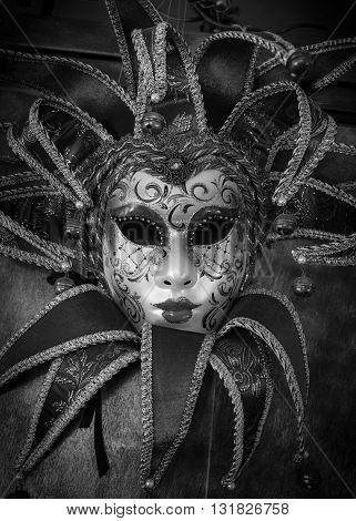 red carnival mask black and white image