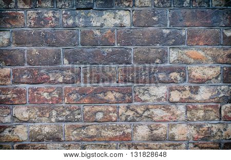 Old vintage brick walls of the old red clay bricks