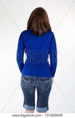 Back View Of Brunette Wearing Blue Denim Jeans And Blue Top