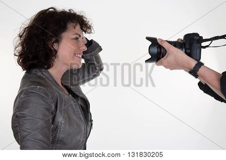 Profile View Of Hands Of Photographer Holding Camera