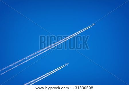 Two Jet Airplanes in the Blue Sky