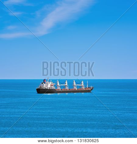 Cargo Ship in the Black Sea under the Blue Sky