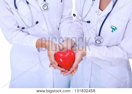 Two woman doctor holding a red heart
