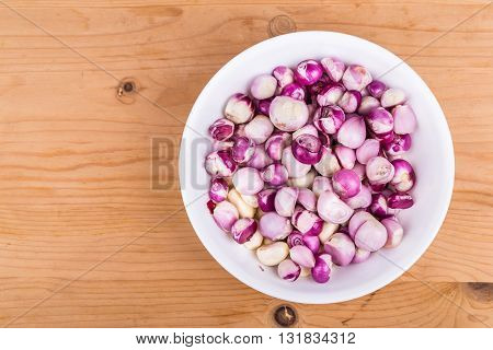 Bowl Of Peeled Shallots Onion And Garlic On Wooden Table