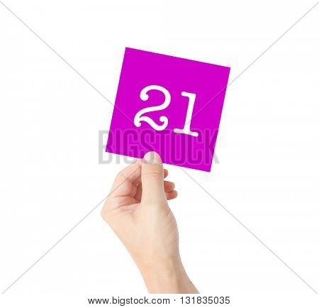21 written on a card held by a hand
