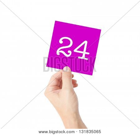 24 written on a card held by a hand