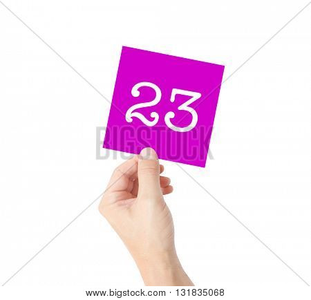 23 written on a card held by a hand