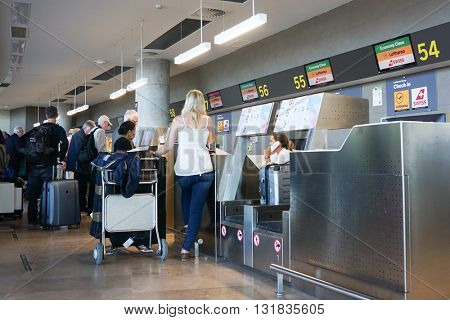 VALENCIA, SPAIN - MAY 29, 2016: An airline passenger checking in at an airline counter in the Valencia Airport. About 4.98 million passengers passed through the airport in 2015.