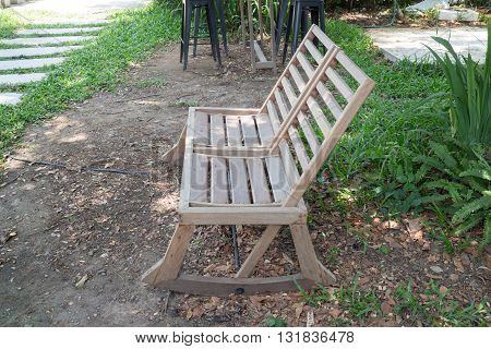 Double outdoor wooden chairs in garden stock photo