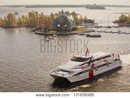 HELSINKI, FINLAND - MAY 19, 2012: Estonian speed boat Karolin of Linda Lines comes in waters of Helsinki from Tallinn