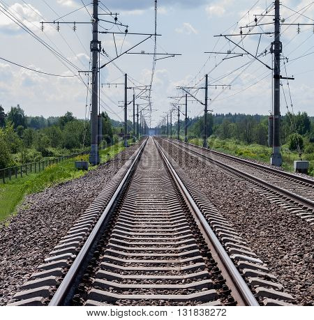 Direct railroad tracks and support with electric wires