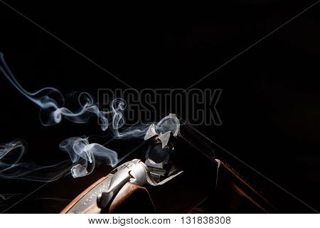 Smoke from a hunting rifle after firing