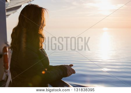 Young Caucasian Woman Starring At The Sunset