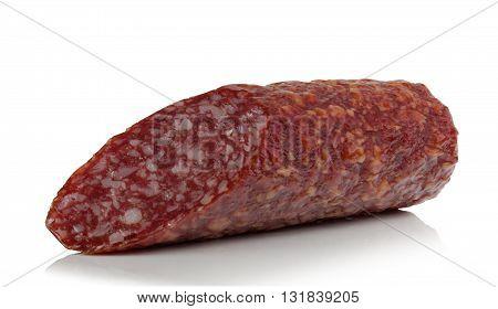 piece of smoked sausage on white background