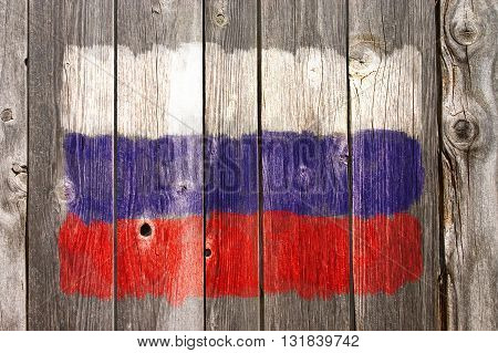 russian colors painted on old wooden wound