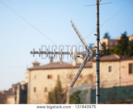 Television or radio antenna on the house roof close-up.