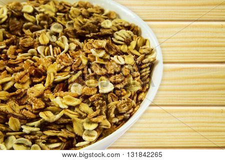 Oatmeal porridge close up on wooden background