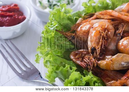 Fried shrimp with lemon & salad on wooden background