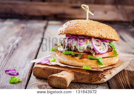Homemade Burger With Beef Cutlet, Apple, Lettuce, Onion And Blue Cheese