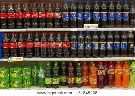 PATTAYA THAILAND - NOVEMBER 16 2014: Shelves with bottles of Coca Cola Pepsi Cola Fanta and Sprite in Central Festival Pattaya Beach mall. Thailand