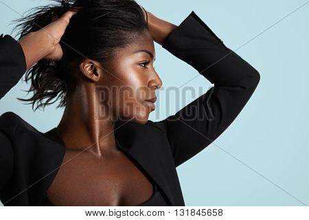 Pretty Black Woman With Ideal Profile Put The Hands On A Hair, Lifted Up