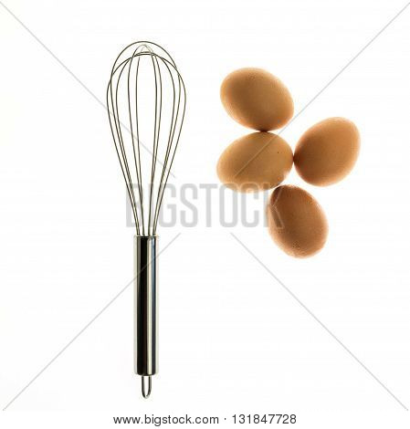 Metal whisk and eggs for a minimalist composition