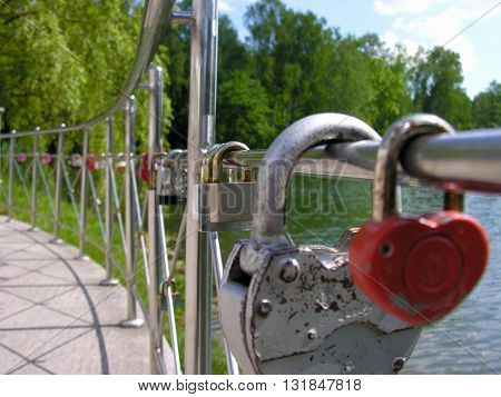 Wedding tradition - to seal the union lock on the fence embankment