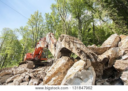Excavator with big shovel to work with rocks