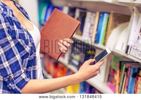 Girl With Gadget At The Bookshop