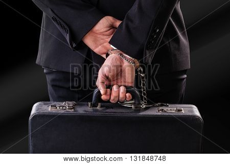 Old Suitcase Secured To The  Wrist With Handcuffs
