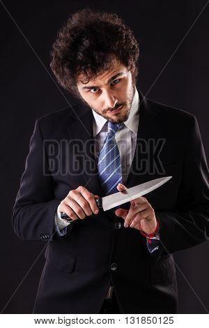 Psycho Businessman Holding A Kitchen Knife