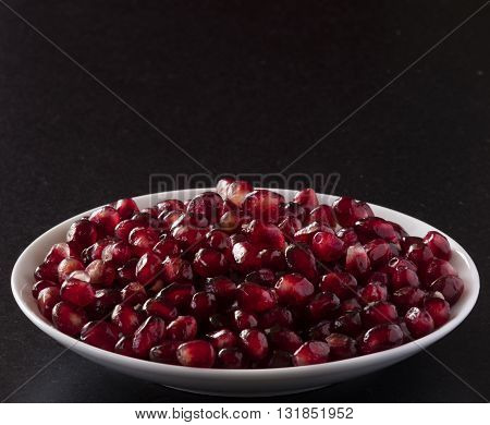 pomegranate seeds with free space on top for text big size photo and high resolution