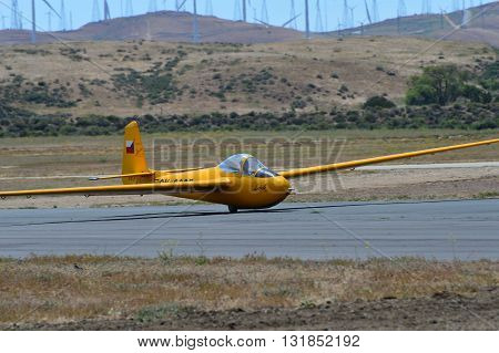 TEHACHAPI, CA - MAY 28, 2016: A 1950 Letov LF-107 sailplane takes off behind a tow plane which will take it to altitude during the Western Vintage/Classic Regatta at Mountain Valley Airport.