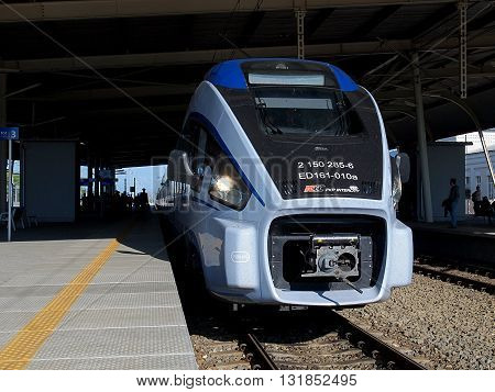 Lodz, Poland - May 09, 2016: Modern train at platform, before the departure of the train station in Lodz Widzew Lodz.