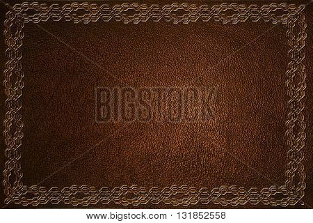 brown leather background with embossed pattern closeup