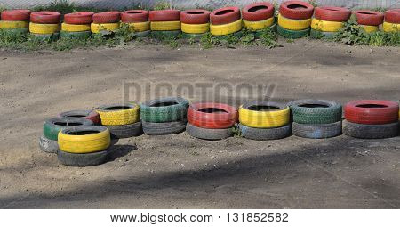 Fencing of tires painted with paint of different colors .