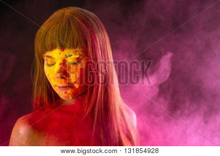 charming woman in colors Holi in studio