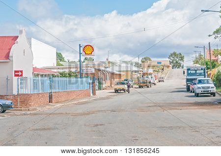 NOUPOORT SOUTH AFRICA - MARCH 8 2016: A street scene in Noupoort in the Northern Cape Karoo Region. Businesses people and cars are visible