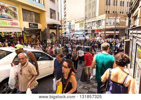 SAO PAULO, BRAZIL - CIRCA JAN 2015: Crowed streets along 25 de Marco in Sao Paulo, Brazil
