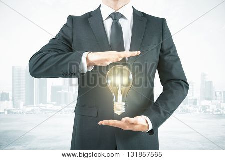 Businessman With Lightbulb Abstract City