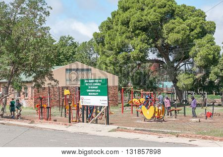 NOUPOORT SOUTH AFRICA - MARCH 8 2016: Unidentified children using innovative outdoor gym equipment in Noupoort in the Northern Cape Karoo Region.