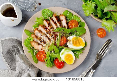 Chicken salad with leaf vegetables chard eggs bulgur and cherry tomatoes