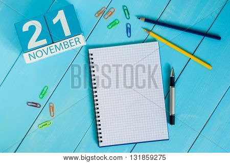 November 21st. Image of november 21 wooden color calendar on blue background. Autumn day. Empty space for text.