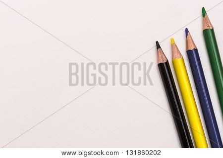 Colour pencils lay on white background school design