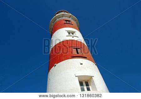 Low angle shot of lighthouse on sky background