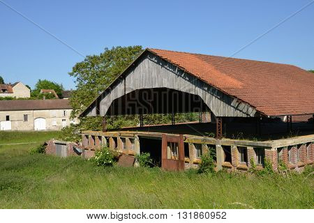 Theuville France - june 4 2015 : ruin of an old factory in summer
