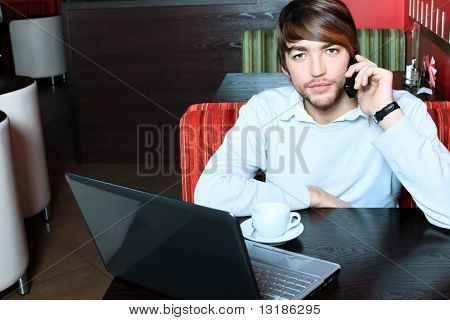 Young business man having a break at a caf