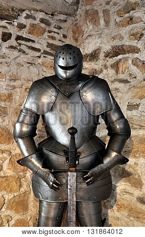 detail of old metal armor in the castle