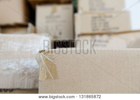 Pile Of Brown Old Used Cardboard Boxes At Warehouse Of Market